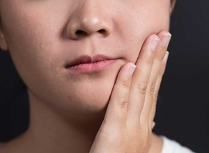 boca inchada por causa do dente
