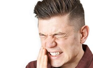 dente furado sintomas