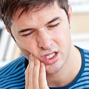 Dente do siso inflamado sintomas